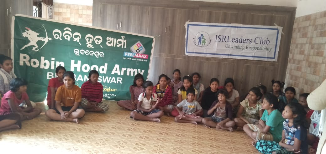 Distribution of Snacks among the inmates of a Child Care Centre in association with Robin Hood Army in Bhubaneswar