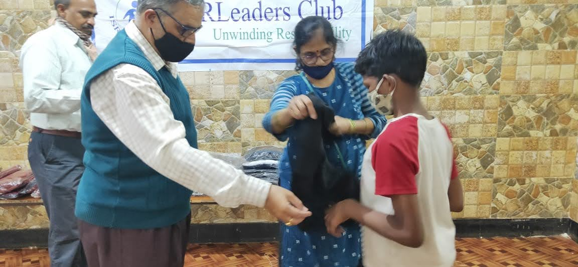 Executive Body Members giving sweater to an inmate at Adruta Children\'s Home