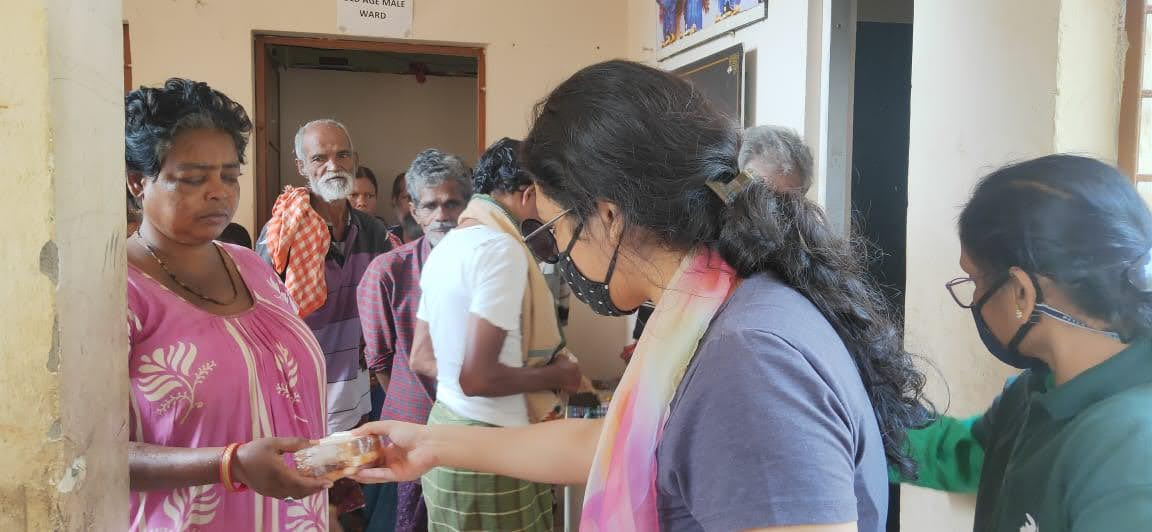 Distributing packaged food at BMC Home Shelter for Old & Children