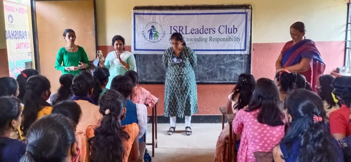 Smt. Radha Subudhi teaching the girls about the hygienic practices