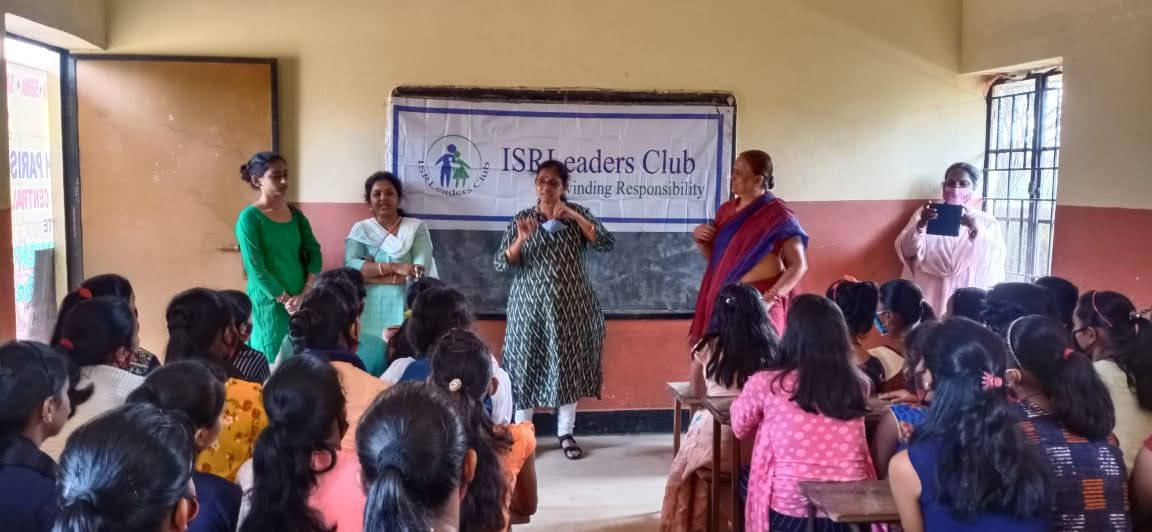 Smt. Rohini Subudhi teaching the girls about the hygienic practices