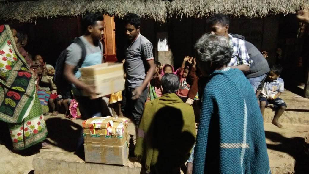 Distribution of food packets at a slum area in Bhubaneswar