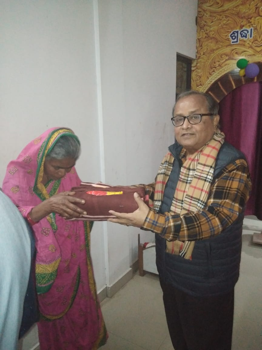 Life Member Subir Mitra distributing blanket and food in an Old Age Home