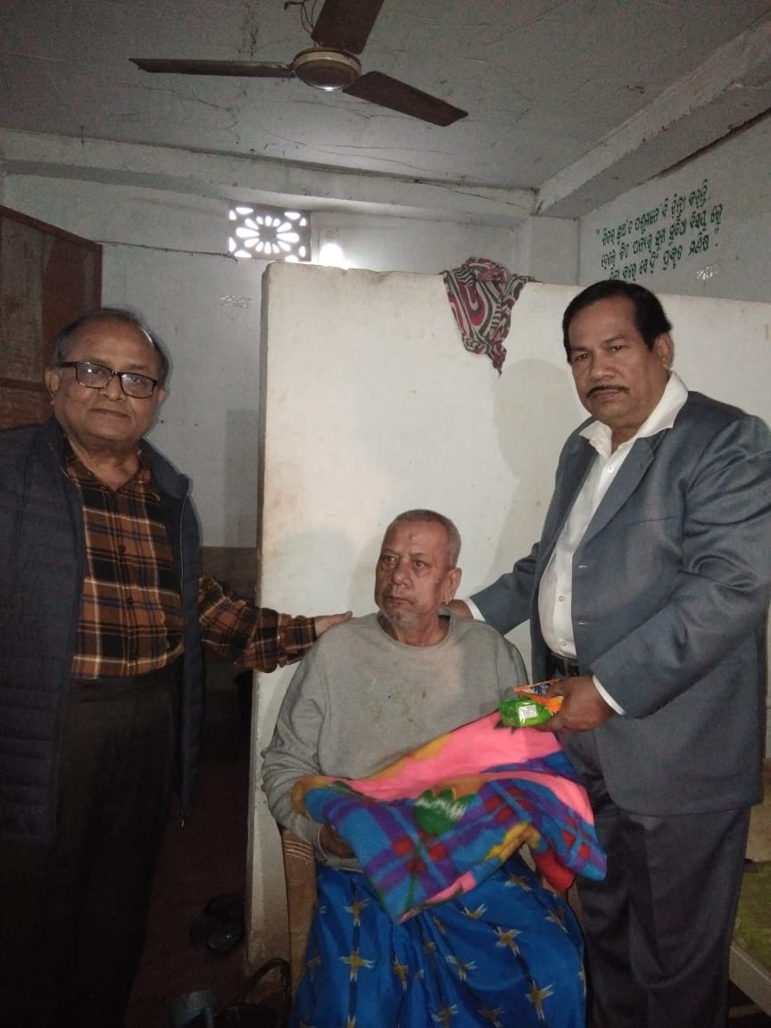 Life Member Dr. M. P. Rout & Subir Kumar Mitra donating food and bkinkets in an Old Age Home