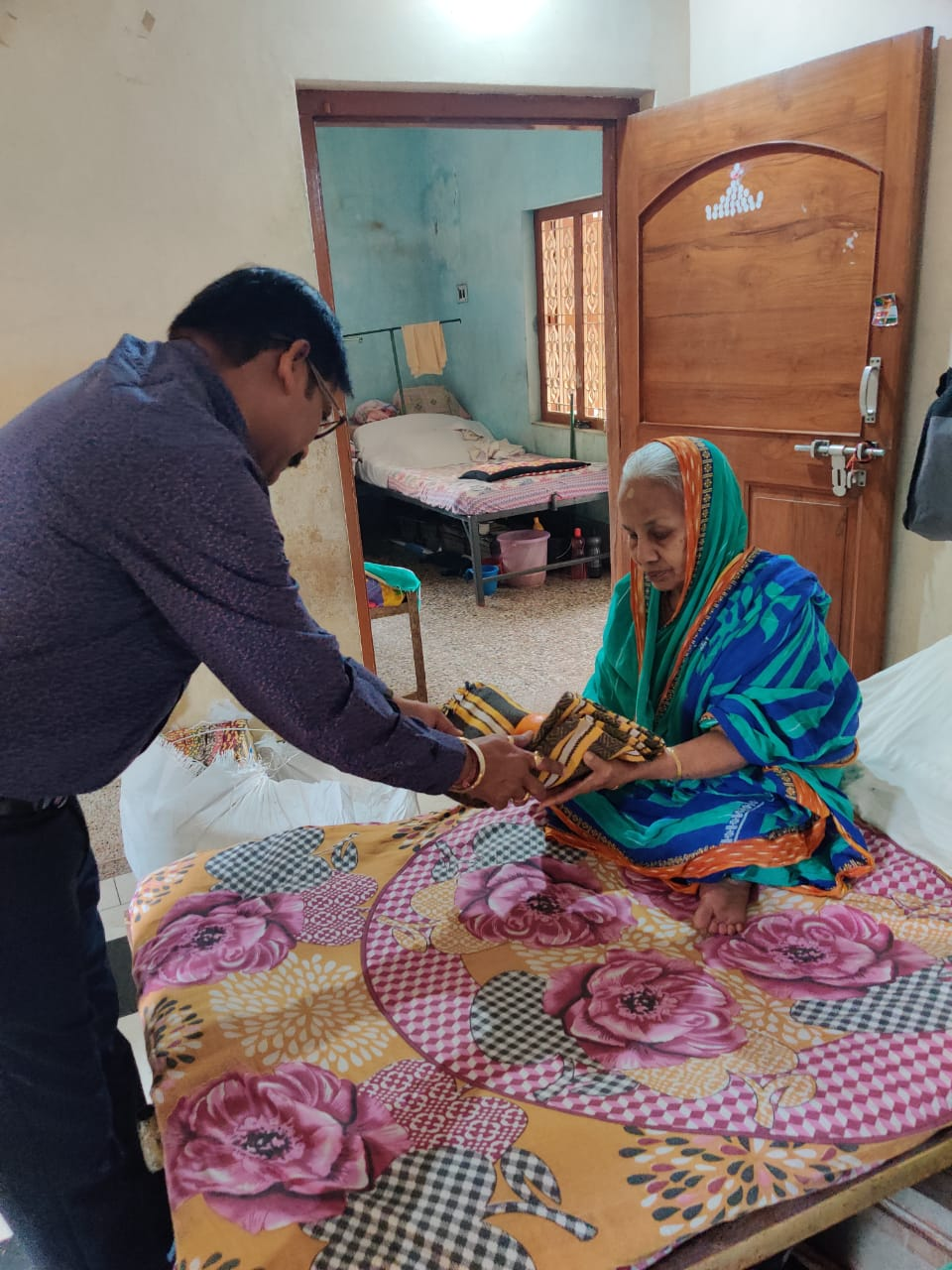 Leaders distributing blankets and fruits at an Old Age Home near Berhampur